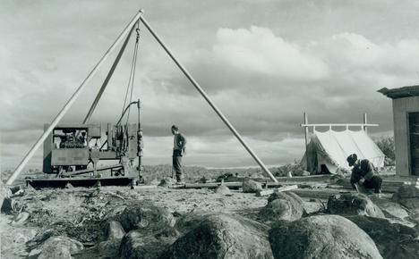Damond drillers at work in the Snowy Mountains, tent in background